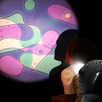 Sensory projector with child violet green
