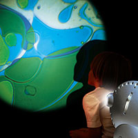 Sensory projector with child blue green
